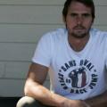 SansRival – Daniel Odvarko wearing white t-shirt