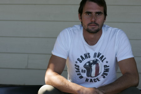 SansRival - Daniel Odvarko wearing white t-shirt